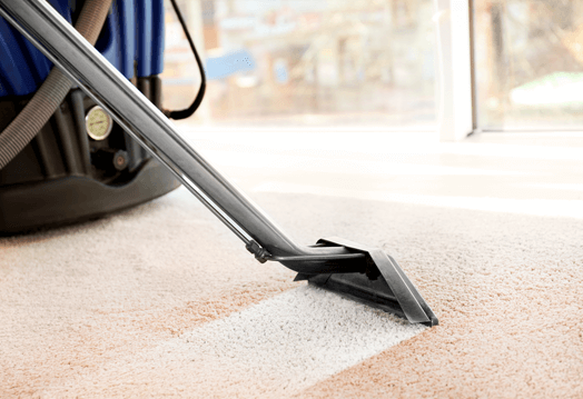 Image of a dirty carpet being cleaned by a carpet cleaning wand tool.