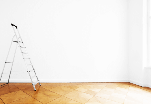 Image of a painted white wall with a step ladder.